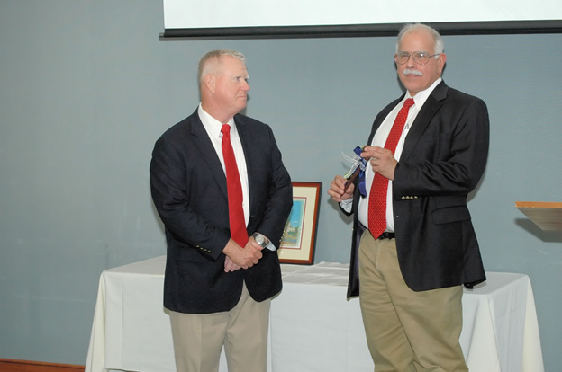 (L-R) Ed Fitzgerald receiving the passing of the gavel as incoming Foundation Chair from former Chair Rafael A. Porrata-Doria.   June 2015.